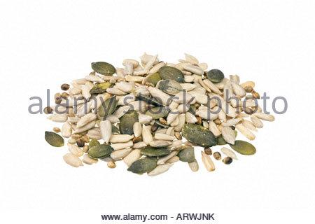 Mixed seeds. Mixture of sunflower seeds, pumpkin seeds and hemp seeds. - Stock Photo
