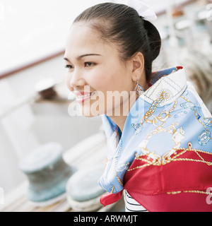 Side profile of a young woman smiling - Stock Photo