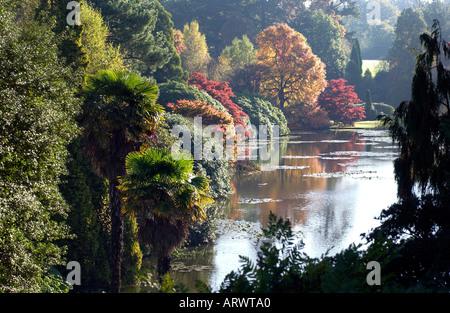 Glorious autumn colour tints leaves at Sheffield Park Gardens near Haywards Heath East Sussex - Stock Photo
