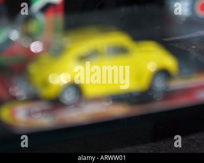 vw beetle model car in toy shop - Stock Photo