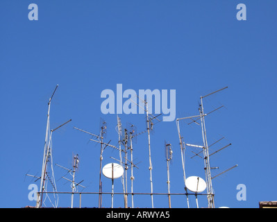 tv aerials on rooftop - Stock Photo