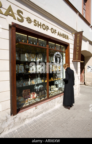 Amber shop and tourist in Vilnius Lithuania - Stock Photo