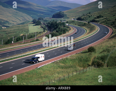 M6 motorway and railway line passing through scenic area on the fringes of The Lake District National Park - Stock Photo