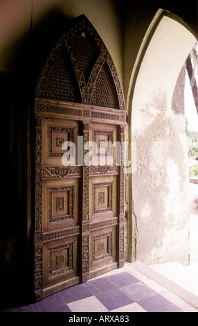 Typical traditional wooden carved door in the stone town of Zanzibar Tanzania East Africa - Stock Photo