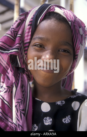 A smiling young teenage girl in the old stone town of Zanzibar Tanzania East Africa - Stock Photo