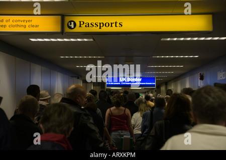 UK Border passport control queue at Glasgow Airport - immigration and arrivals - Stock Photo