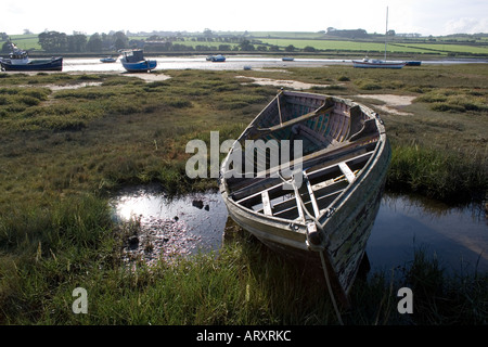 Boat high and dry on tidal Alnmouth estuary in Northumberland UK - Stock Photo