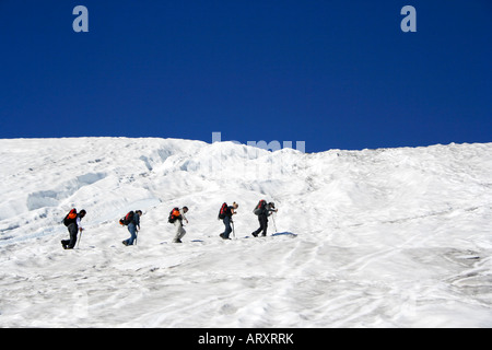 People climbing snowy Villarrica Volcano's western slope, near Pucon, Chile, South America - Stock Photo
