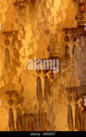 impressionistic candelabra behind textured glass still life special effect repeating image photographed through - Stock Photo