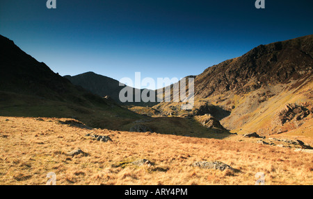 wide view of Cader Idris or cadair idris in Snowdonia North Wales showing scrubby foreground and steep ascents in - Stock Photo