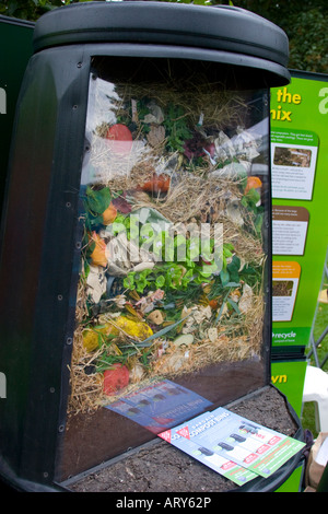 Cutaway compost bin to show section through rotting food waste inside - Stock Photo