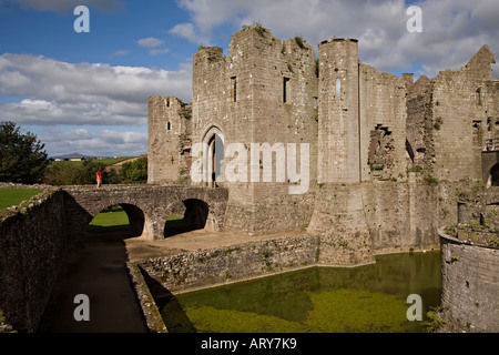 Woman looking at the South Gate Raglan Castle Monmouthshire Wales UK - Stock Photo