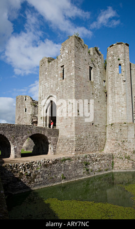 Visitor walking through the South Gate Raglan Castle Monmouthshire Wales UK - Stock Photo