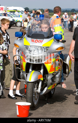 Blood transfusion service fast response transport motorbike - Stock Photo