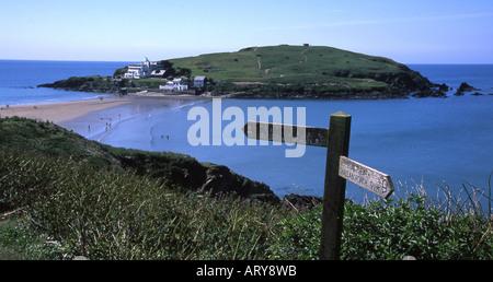 On the south west coast path near Bigbury on Sea, looking across to Burgh Island, south Devon - Stock Photo