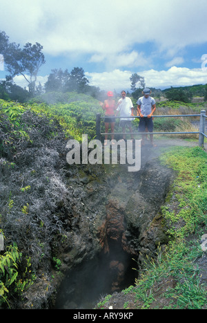 People get a close up view of the Steam Vents along Steaming Bluff. Located along Crater Rim Drive and Kilauea Volcano - Stock Photo
