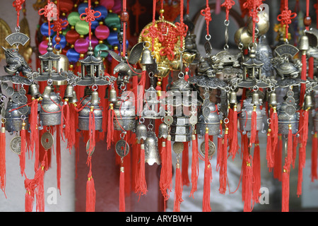 Colorful chinese ornaments adorn many storefront windows in Chinatown, downtown Honolulu, Oahu - Stock Photo