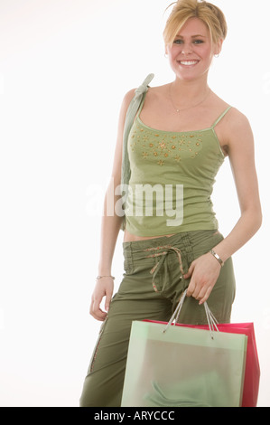 Confident woman with shopping bags - Stock Photo