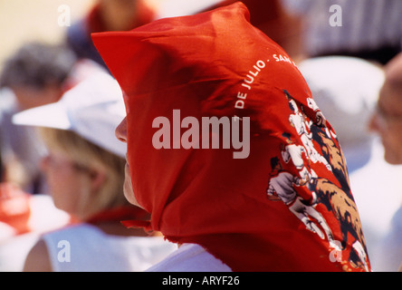 a woman wearing a typical sanfermin handkerchief during a bullfight in Pamplona Spain - Stock Photo
