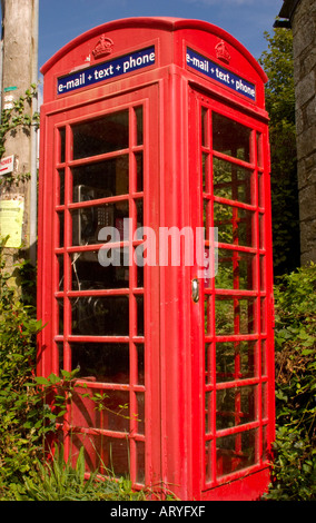 Traditional red telephone box offering email and texting facilities for the local community in a rural village in - Stock Photo
