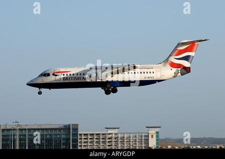 British Airways Avro RJ100 aircraft landing at Birmingham International Airport, England, UK - Stock Photo