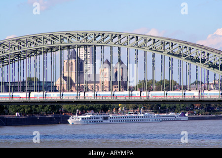 Hohenzollern Bridge with tourist boat Cologne North Rhine Westphalia Germany - Stock Photo