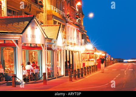 Nightly iluminated Restaurant mall in oyster capital Cancale, Brittany, France - Stock Photo