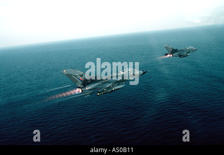 Tornado GR1 aircraft flying low level over the sea - Stock Photo