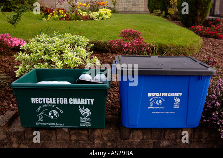 Boxes for recycling household rubbish ready for collection on garden wall outside a house in Newport South Wales - Stock Photo