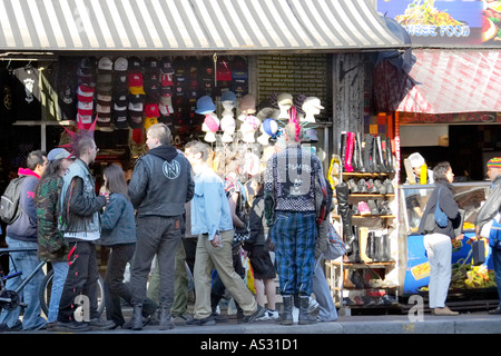 Punk mohicans in Camden town market in London UK - Stock Photo