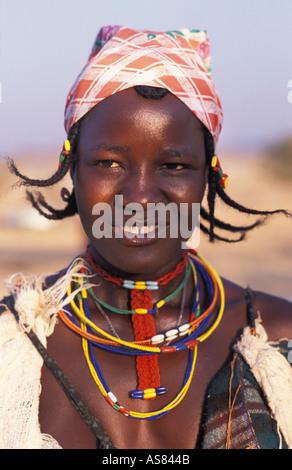 Opuwo Zemba Dhimba woman in tribal costume with adornments Angolan tribe Namibia - Stock Photo