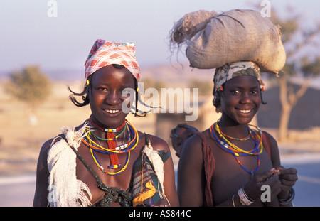 Opuwo Namibia Zemba Dhimba women in tribal costume Angolan tribe - Stock Photo