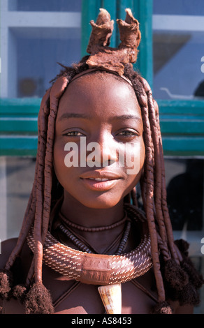 Teenage Himba girl showing her distinctive hair decoration and tribal adornments Opuwo Namibia - Stock Photo