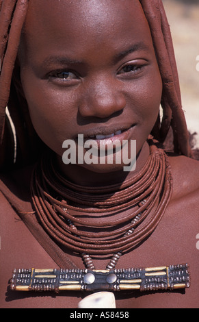 Himba woman and her distinctive hair decoration and adornments Kaokoveld south of Opuwo Namibia - Stock Photo