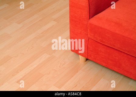 red sofa on a wooden floor - Stock Photo