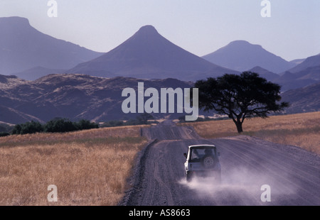 Ancient landscape Palmwag to Sesfontein Extinct volcanoes and tabletop mountains Travelling by 4x4 on gravel roads - Stock Photo