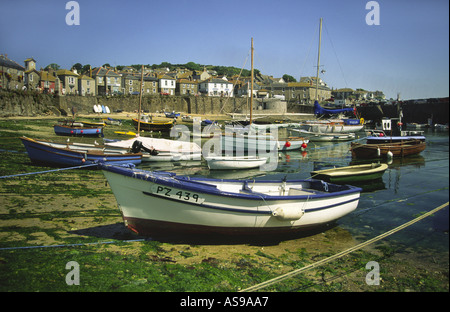 Mousehole Harbour in Cornwall England UK - Stock Photo