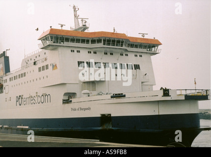 Cross channel ferry unloading and cars waiting to load at Calais in France - Stock Photo