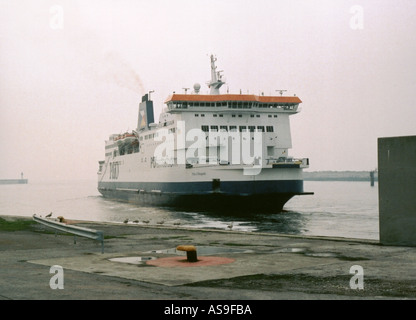 Cross channel ferry docking in Calais France - Stock Photo