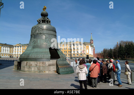 Moscow Russia Tourists at The Tsar Bell within The Kremlin complex - Stock Photo