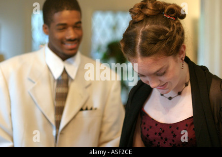 Detroit Michigan Mariel West 15 and Christian Davis 17 prepare for the Regina High School homecoming dance - Stock Photo