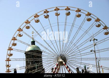 big wheel on Koninginnedag Dam Square Amsterdam Netherlands - Stock Photo