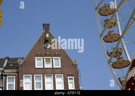 big wheel on Koninginnedag Dam Square and ABN Amro Building Amsterdam Netherlands - Stock Photo