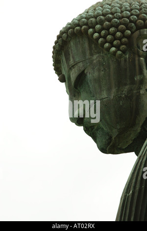A profile image of the face of the great Buddha statue at Kotokuin Temple in Kamakura, Japan - Stock Photo
