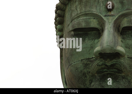 A close up image of the face of the great Buddha statue at Kotokuin Temple in Kamakura, Japan - Stock Photo