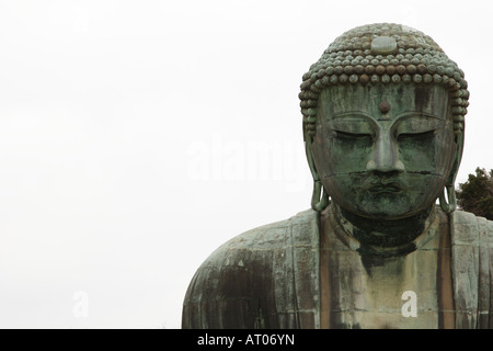 A classic image of the face of the great Buddha statue at Kotokuin Temple in Kamakura, Kanagawa, Japan - Stock Photo