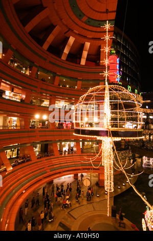 Evening view of Canal City shopping mall and entertainment complex in Fukuoka Japan - Stock Photo
