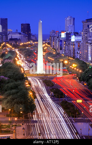 Aerial view of 9 de Julio Avenue, with Obelisco Monument, at dusk, with car lights as lines. Long exposure Buenos - Stock Photo