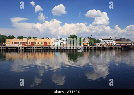 "Old cranes and houses at Construction material Store by the ""Riachuelo"" River, at ""La Boca"", Buenos Aires, Argentina - Stock Photo"