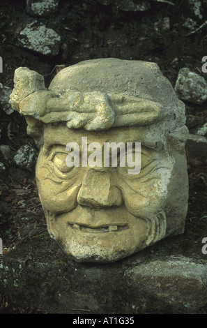 Carved face at Mayan ruins Maya stela Mayan ruins of Copan Honduras - Stock Photo